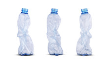 Three Crushed Plastic Bottles