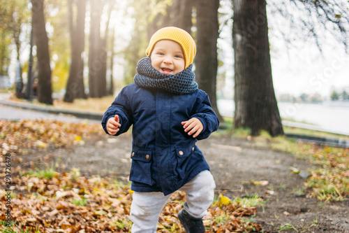 Canvastavla  Cute happy baby boy in fashionable casual clothes in autumn nature park