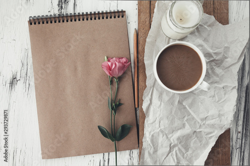 Fototapeta Sketchbook and coffee on wooden tray obraz