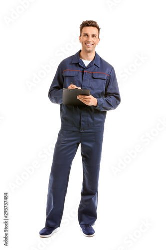 plakat Male car mechanic with clipboard on white background