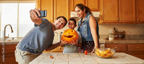 Canvas Prints Coffee bar family taking selfie with jack-o-lantern for halloween