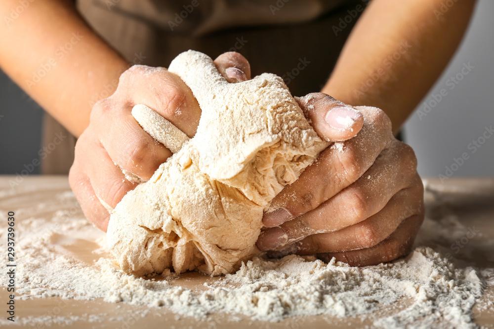 Fototapety, obrazy: Woman kneading flour in kitchen, closeup