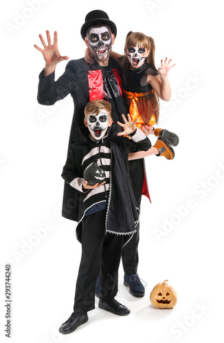Fotografija Father with children in Halloween costumes and with pumpkins on white background