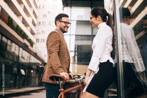 Office woman with business man couple enjoying break while talking flirting outd Fototapet