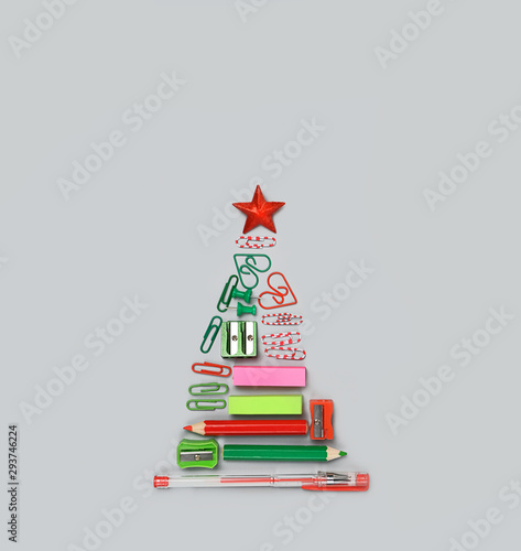 Fotografija  symbol Christmas tree made of stationery, pens, pencils, paper clips, office supplies