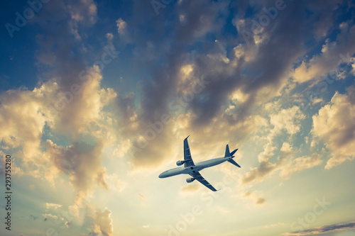 Poster Avion à Moteur Airplane on blue sky and clouds, fly concept