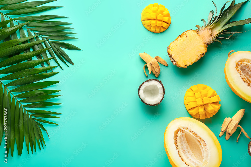 Fototapety, obrazy: Sweet ripe fruits with tropical leaves on color background