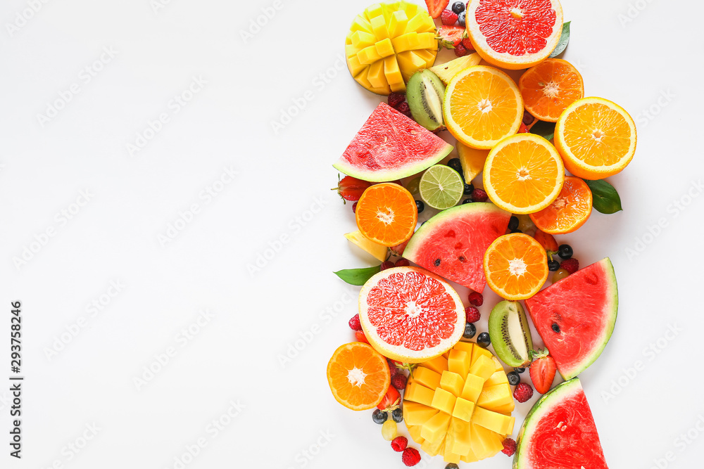Fototapeta Sweet ripe fruits and berries on white background
