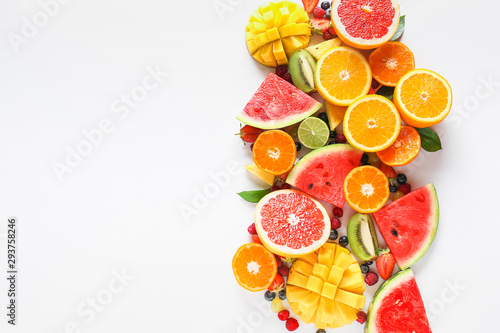 Sweet ripe fruits and berries on white background - 293758246