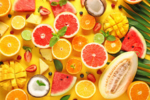 Sweet Ripe Fruits And Berries On Color Background