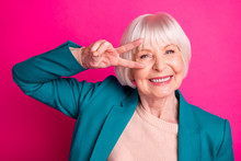 Close-up Portrait Of Her She Nice Attractive Cheerful Cheery Funky Gray-haired Lady Wearing Blue Jacket Showing V-sign Near Eye Isolated On Bright Vivid Shine Vibrant Pink Fuchsia Color Background