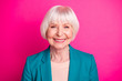Leinwandbild Motiv Close-up portrait of her she nice-looking attractive lovely well-groomed cheerful cheery gray-haired lady wearing green blue jacket isolated on bright vivid shine vibrant pink fuchsia color background