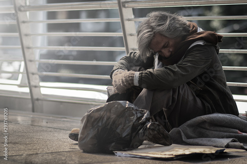Homeless people living in various cities He waited and needed help from the kind people to give him all the necessary things, clothing, bread, water, and home Canvas Print