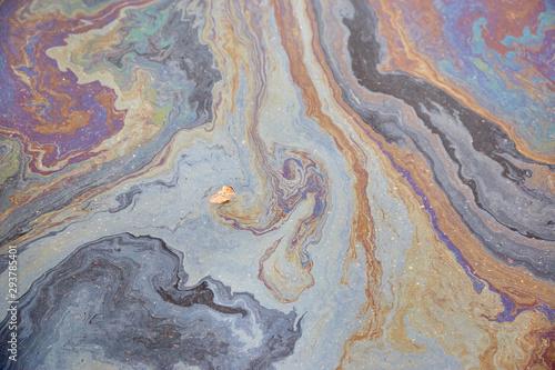 Fototapeta Oil slick on the asphalt road background obraz