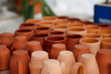 Ceramic Dishes Made Of Red Clay Cups Lie On The Table Close-up