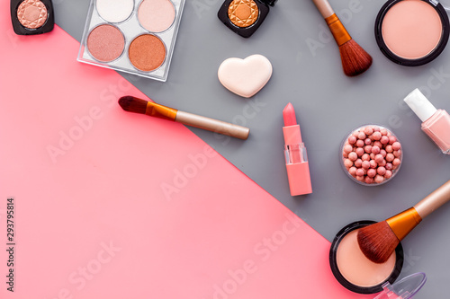 Fototapety, obrazy: Makeup concept. Frame with decorative cosmetics and brushes on pink and grey background top view copy space