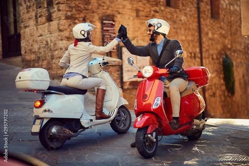 Young Couple on Vespa Scooter. Bikers couple.. Slika na platnu