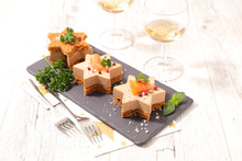 Festive Canape With Foie Gras And Salmon On Gingerbread Toast