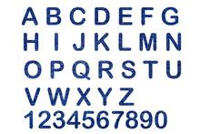 Alphabet Letters On Denim Texture .