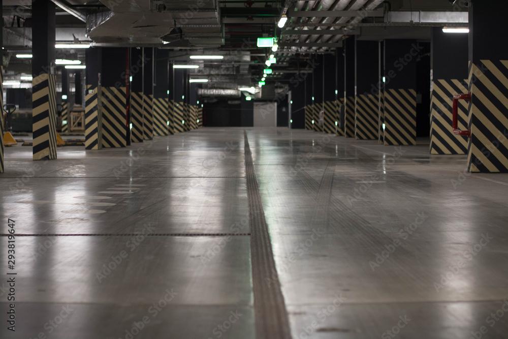 Fototapeta Underground public garage parking with cars, movie style toned