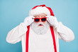 canvas print picture Close up photo of impressed fat overweight santa claus stare in modern eyeglasses look funny funky hear wonder christmas seasonal discounts wear suspenders overalls isolated over blue color background