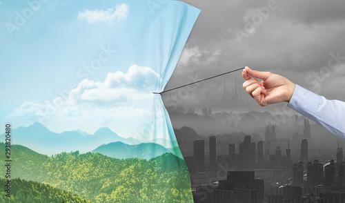 Fototapeta  hand pulling nature cityscape curtain to gray cityscape, environmental protectio