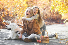 Two Sisters On Fall Background...