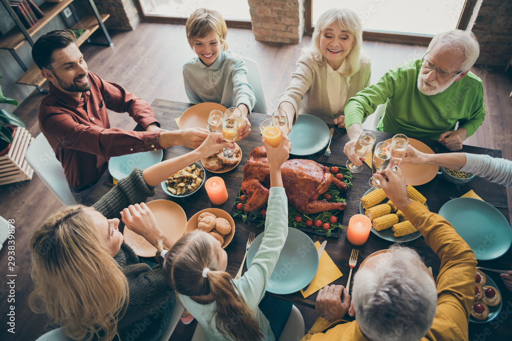 Fototapeta Top above high angle view of nice lovely cheerful big full family brother sister couples eating tasty yummy brunch feast tradition clinking glass in loft brick industrial style interior house indoors