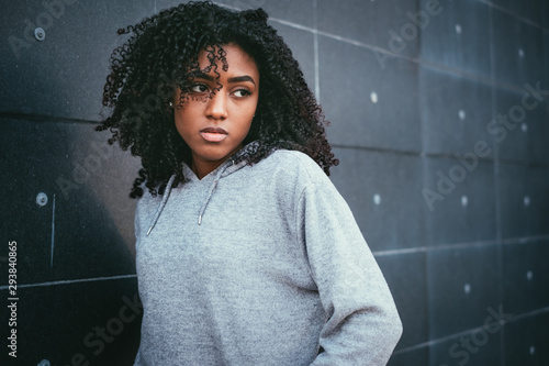 Sad and lonely teenager portrait in the city street Canvas Print