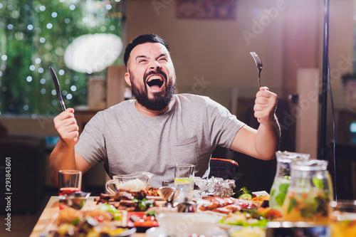 Fototapeta man at the big table with food. obraz