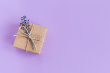 Craft Gift Box With Small Lavender Bouquet On Pastel Violet Background. Holiday Eco-friendly Concept.