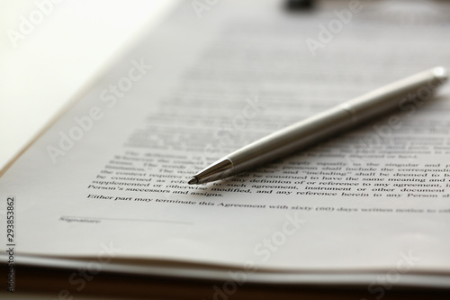 Silver pen lying on form clipped to pad closeup background Fototapet