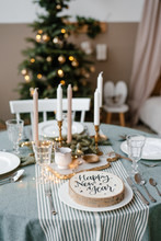 Wood Circle With Happy New Year Inscription On Table Near Fir Tree