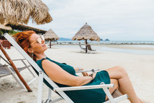 Woman Resting On A Sun Lounger