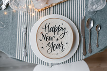 Wood Circle With Happy New Year?inscription On Plate On Table