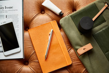 Orange Notebook Surround By Wo...