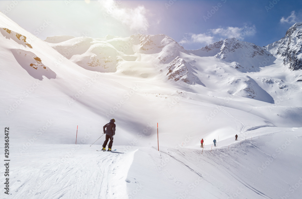Fototapety, obrazy: Several skiers skiing down the slope in beautiful snowy mountain landscape