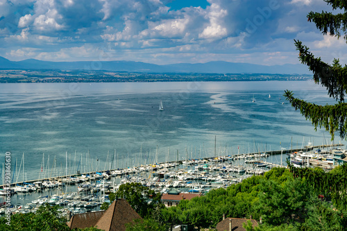 Cadres-photo bureau Bleu jean View from the viewpoint of the port of Thonon les Bains, boats, Lake Geneva, and the blue sky with clouds.Haute-Savoie in France.