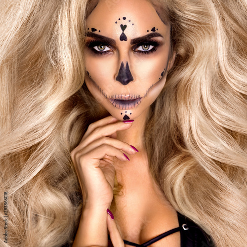 Fototapety, obrazy: Halloween Sexy Witch portrait. Beautiful young woman in witches makeup with long curly colorful hair and bright lips. Wide Halloween party art design - Image