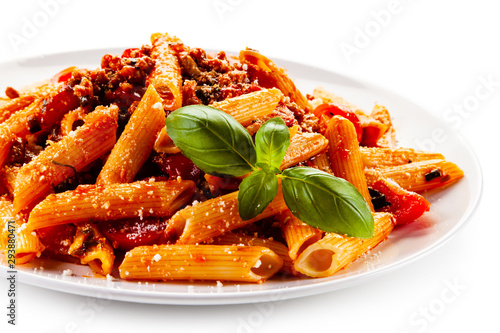 Fototapeta Penne with meat, tomato sauce and vegetables obraz