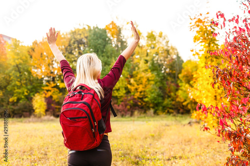 Foto auf AluDibond Orange girl with a backpack in the autumn park
