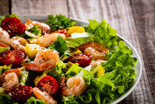 Salad With Shrimps On Wooden B...