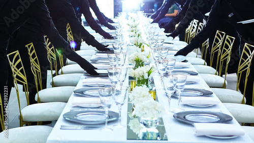 Large group of waiters serving a banquet. Fototapete