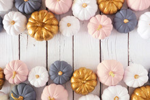 Autumn Double Border Of Dusty Rose, White, Gold And Gray Pumpkins On A White Wood Background. Modern Muted Pastel Colors. Top View With Copy Space.