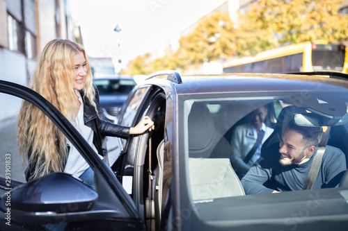 Vászonkép Woman Sitting In Car With Friends