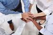 Multiracial Businesspeople Stacking Hands Over Each Other