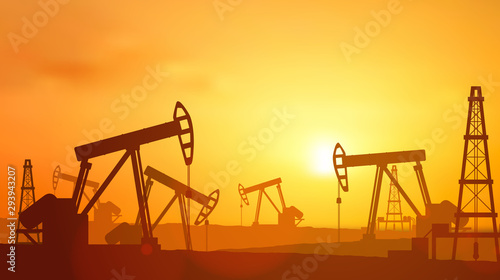 Fotografía  Silhouette Oil pumps at oil field with sunset sky background