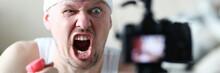 Male Vlogger Holds Dumbbells I...