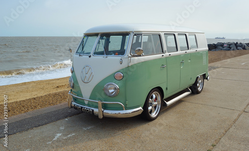 Obraz na plátne Classic Green and white  VW Camper Van parked on Seafront Promenade
