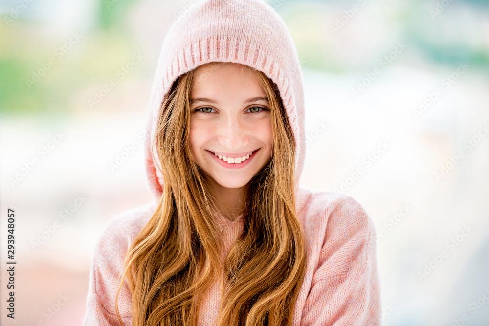 Fototapeta Teenage girl wearing hood